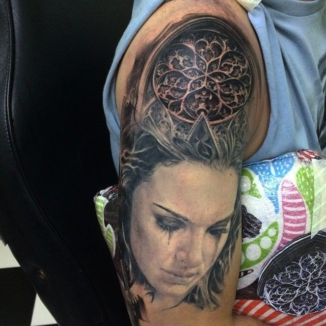 Lifelike colored shoulder tattoo of woman face with medieval cathedral