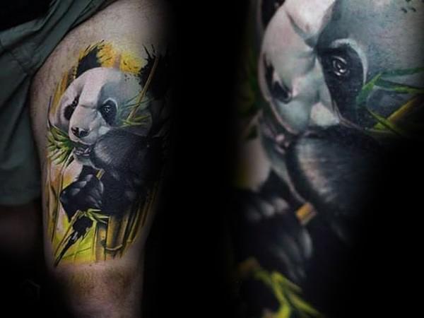 Lifelike colored thigh tattoo of panda bear with bamboo