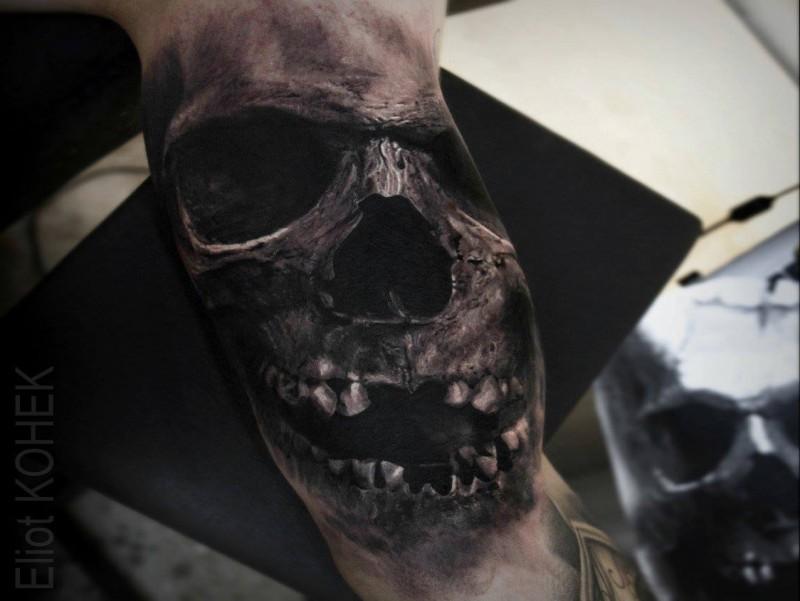 Lifelike detailed biceps tattoo painted by Eliot Kohek of skull