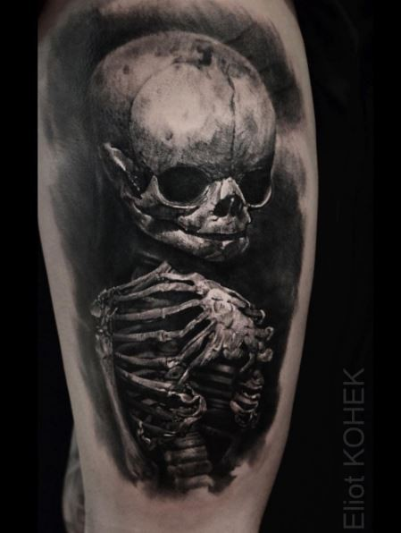 Lifelike detailed tattoo of alien skeleton by Eliot Kohek