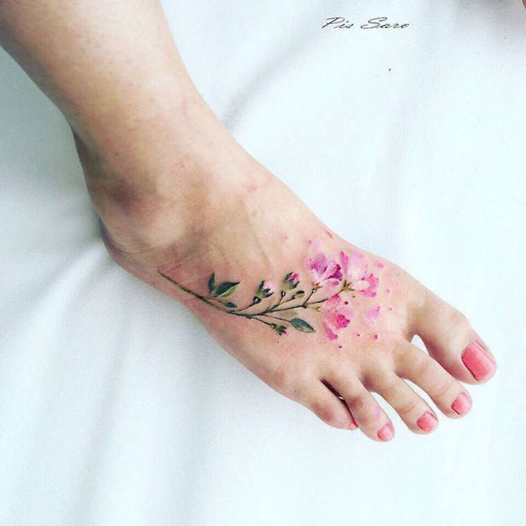 Lifelike sweet looking colored foot tattoo of small flower branch