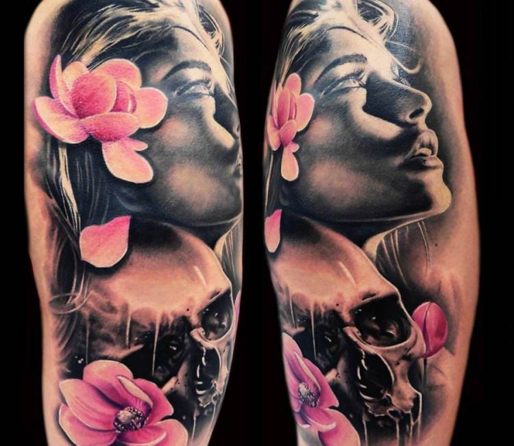 Lifelike very detailed arm tattoo of beautiful woman with skull and pink flowers