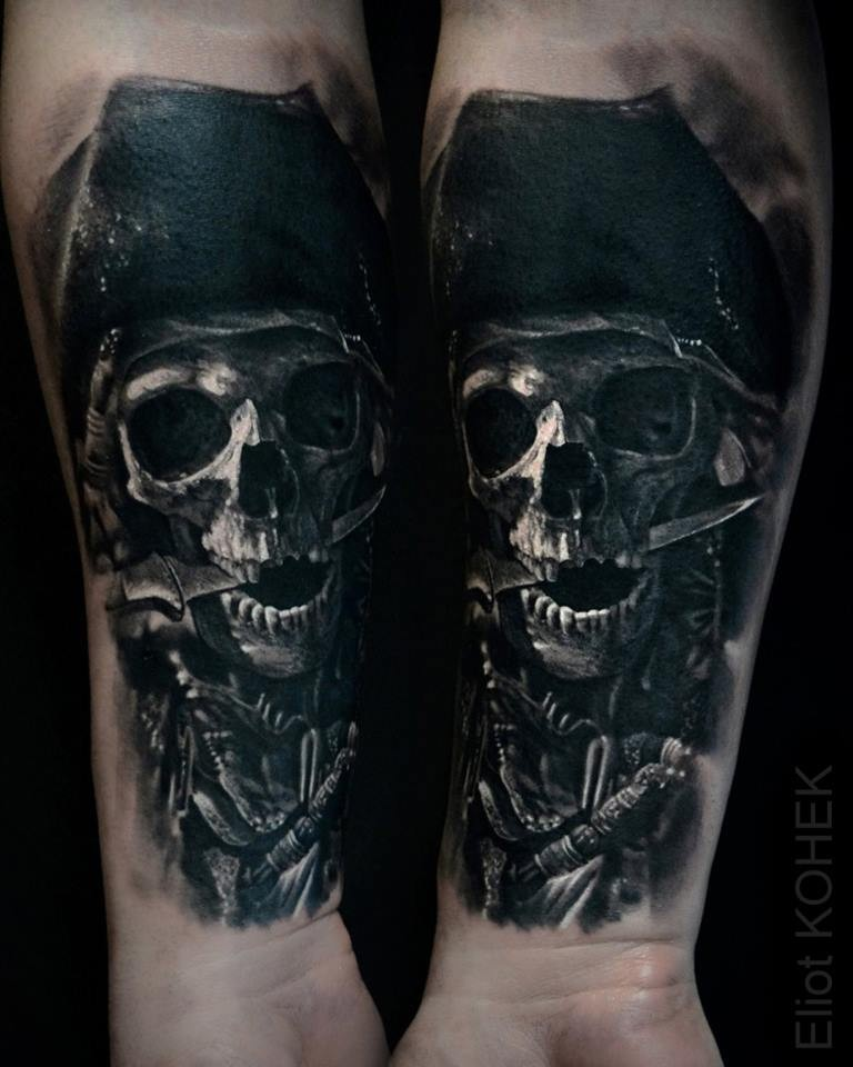 Lifelike very detailed painted by Eliot Kohek forearm tattoo of pirate skeleton with dagger