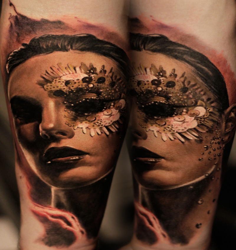Lifelike very detailed tattoo of woman face with small mask