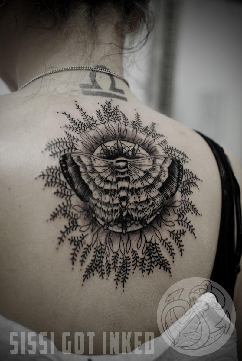 Linework black ink upper back tattoo of butterfly