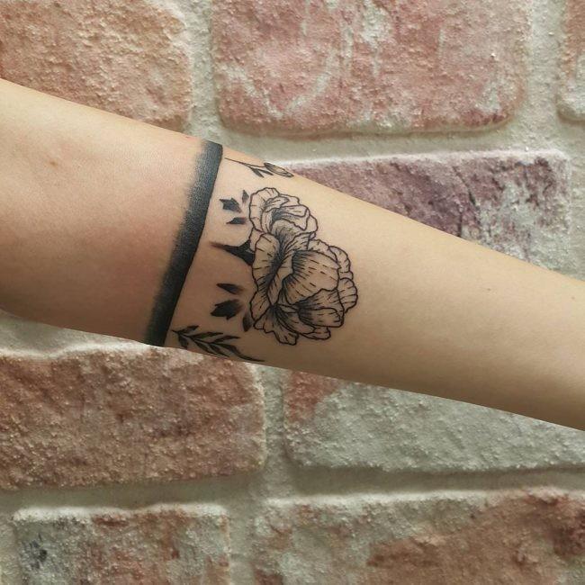 Linework style black ink arm tattoo fo big flower