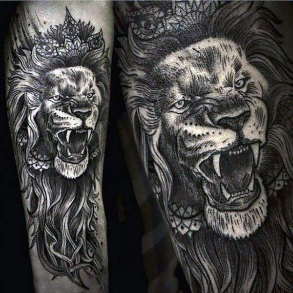 Linework style black ink arm tattoo of roaring lion with crown