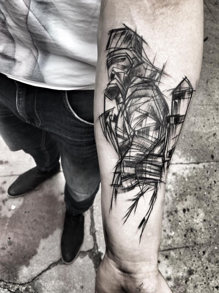 Linework style black ink painted by Inez Janiak forearm tattoo of man with gas mask