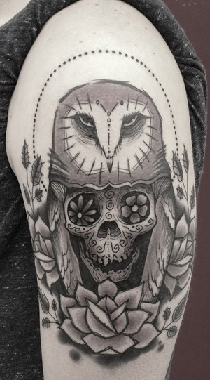 Linework style black ink upper arm tattoo of owl stylized with skull by Dino Nemec