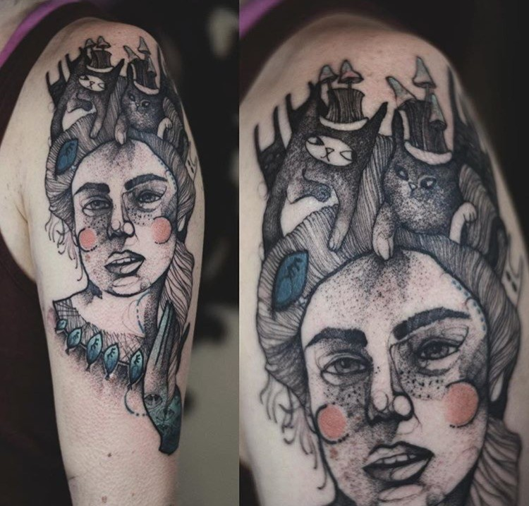 Linework style surreal upper arm tattoo of woman portrait with cat