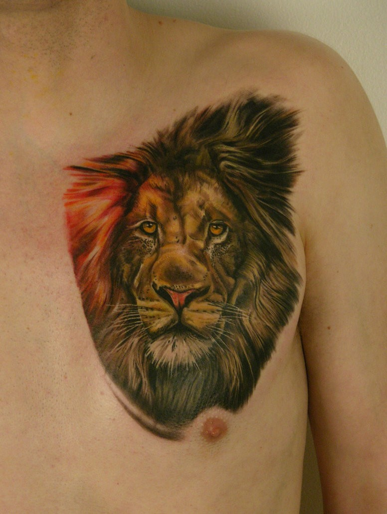 Colourful lion head tattoo chest