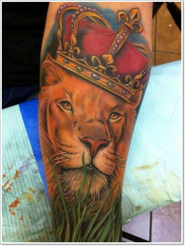 Lion in red royal crown tattoo