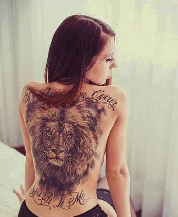 Large lion head tattoo on girl back