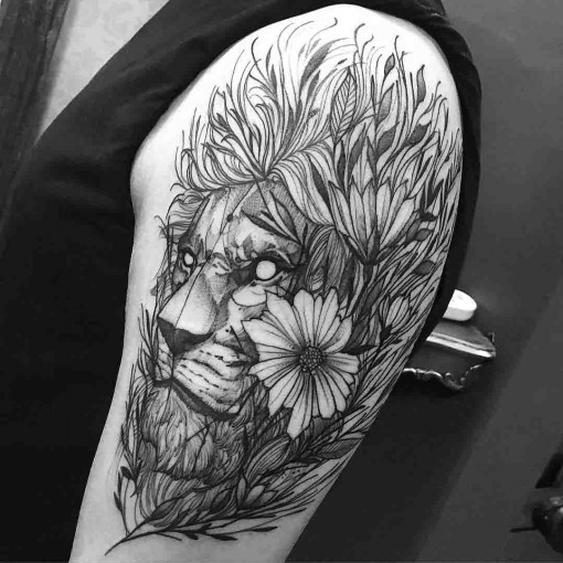 Lion&quots head in flowers tattoo on shoulder in engraving style