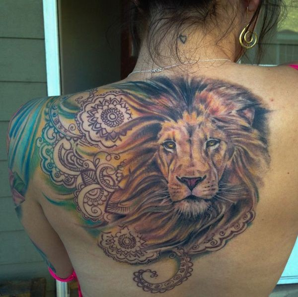 Lions head with squid tattoo on back