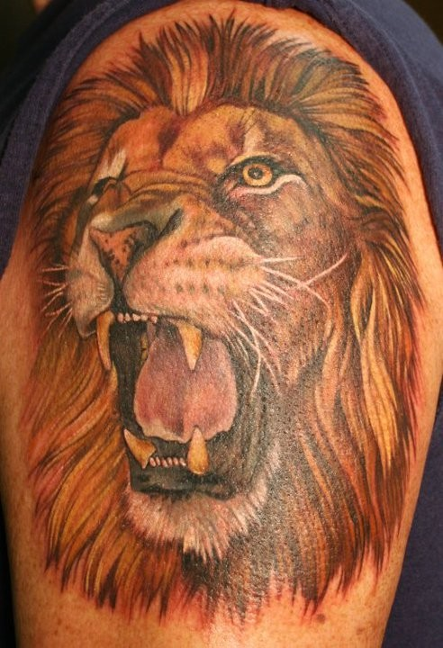 Roaring lion head tattoo on the arm