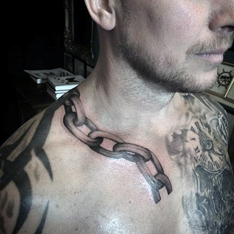 Little 3d like black ink broken chain tattoo on shoulder for Chain tattoo on arm