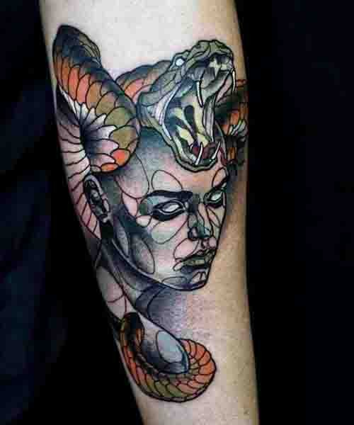 Little 3D realistic evil Medusa with snakes tattoo on arm