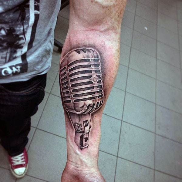 Little 3D style black and white microphone tattoo on arm