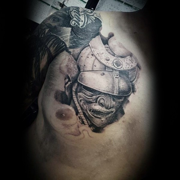 Little 3D style black and white samurai warrior mask tattoo on chest