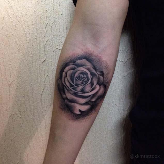 Little 3D style black ink rose flower tattoo on forearm area