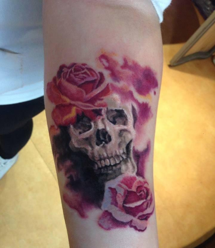 Little 3D style colorful forearm tattoo of skull stylized with flowers