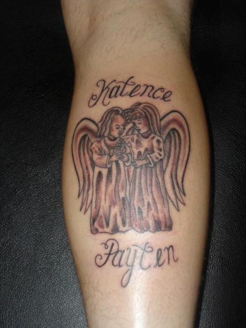 Little angels tattoo on leg