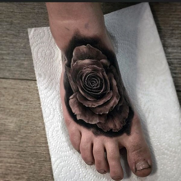 Little black and white 3D rose tattoo on foot
