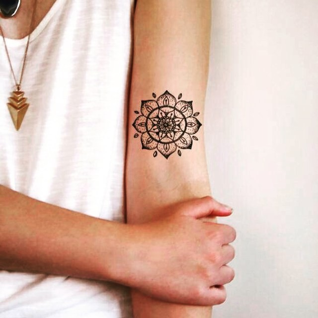 Little black and white arm tattoo of beautiful designed flower