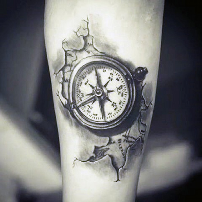 Little black and white detailed compass tattoo on arm