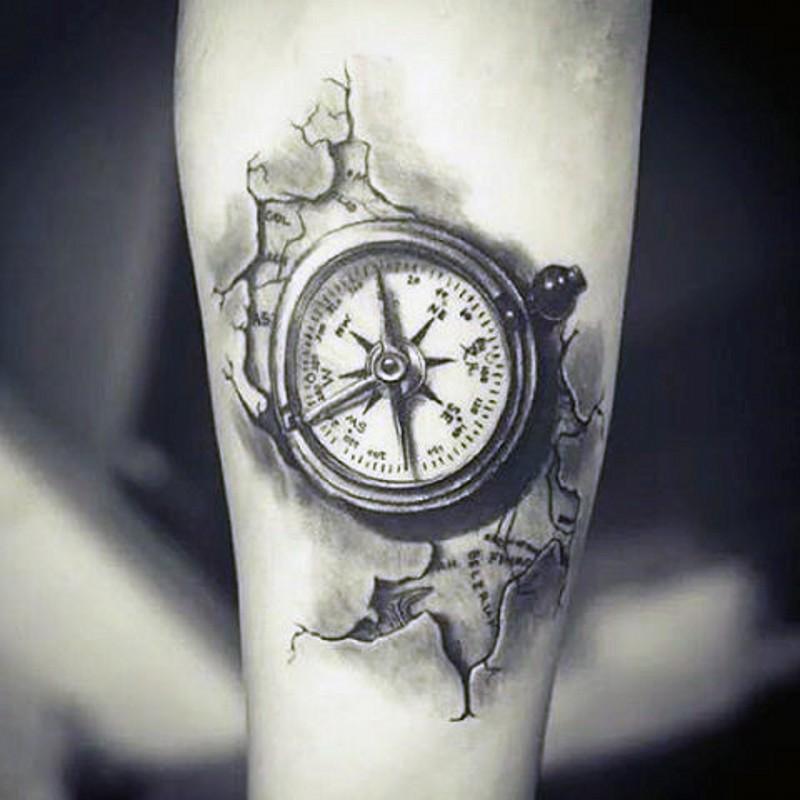 piccolo nero e bianco dettagliato bussola da sotto pelle tatuaggio su braccio