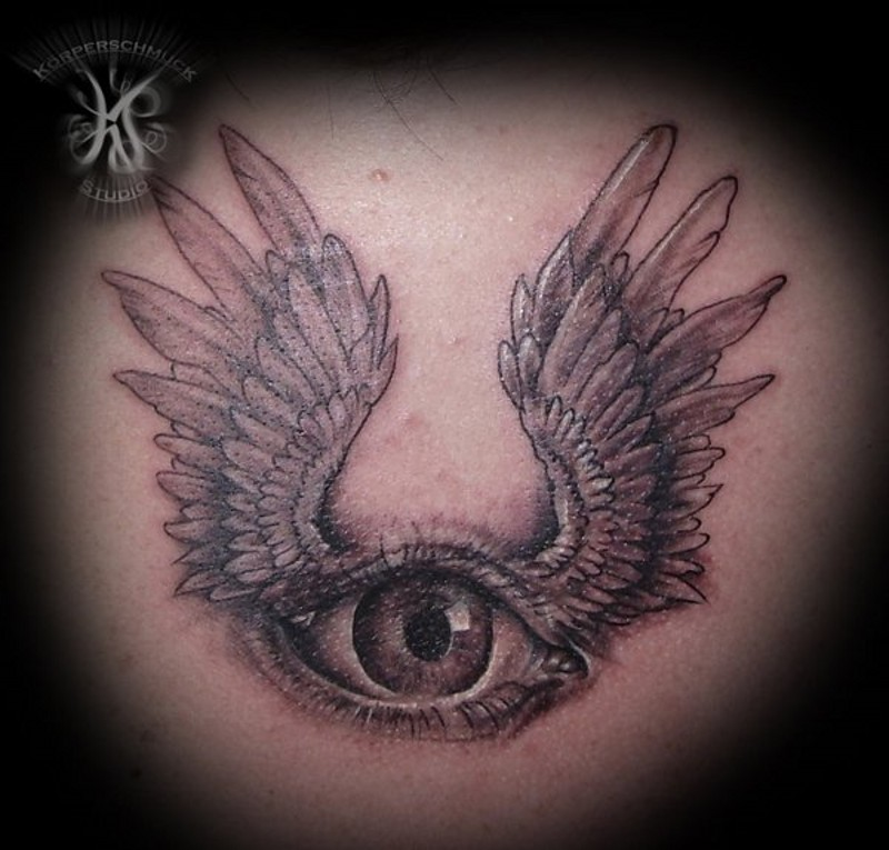 Little black and white eye with wings tattoo on back