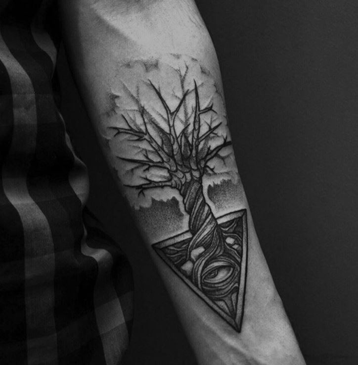 Little black and white lonely tree tattoo on forearm combined with mystic pyramid