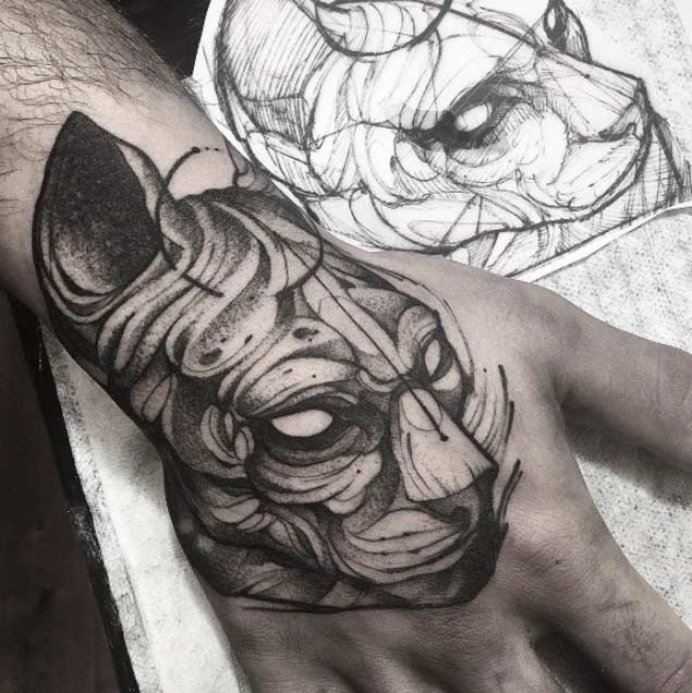 Little black and white mystical demonic cat tattoo on hand