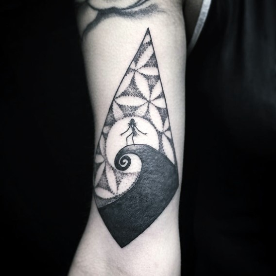 Little black and white mystical tattoo on forearm