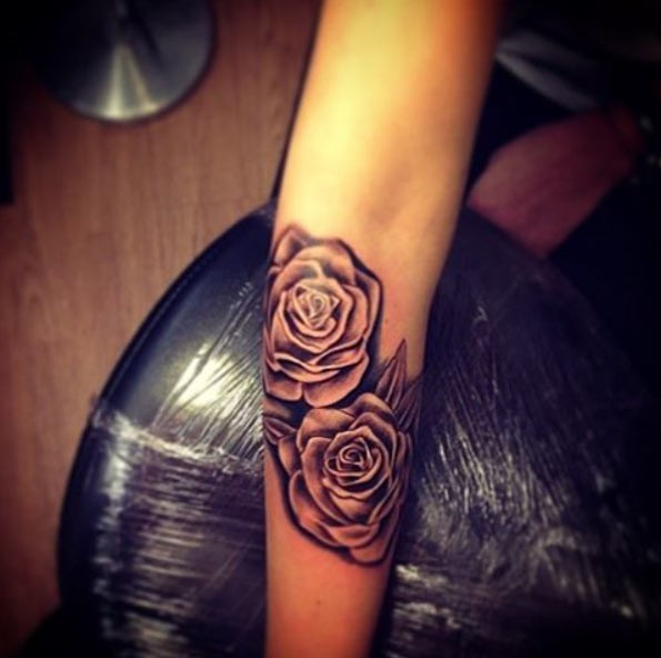 Little black and white natural looking rose flowers forearm tattoo