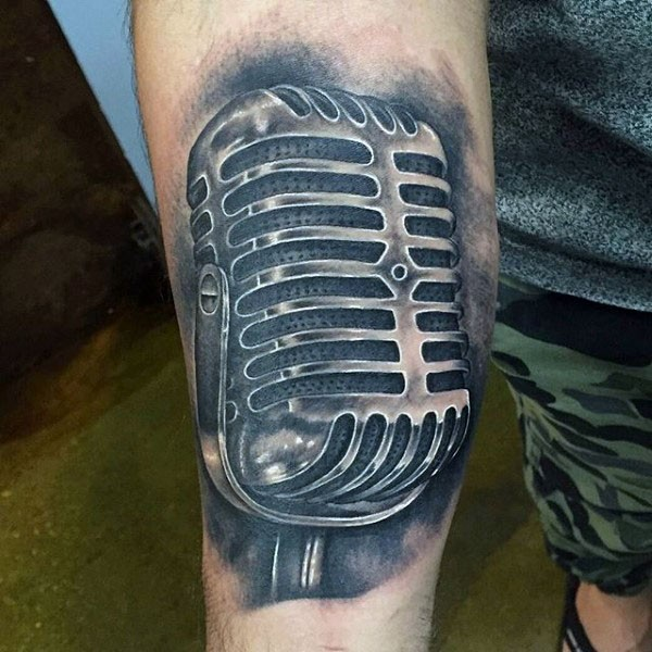 Little black and white realistic microphone tattoo on arm