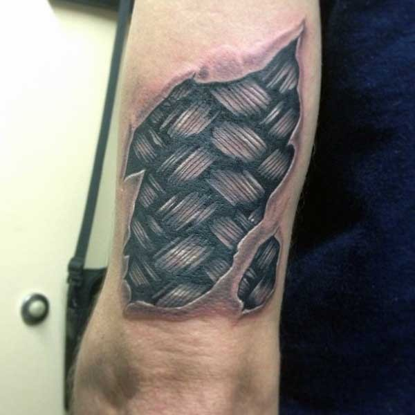 little black and white tree like under skin tattoo on arm