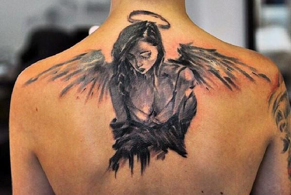Little black ink abstract sad angel tattoo on upper back