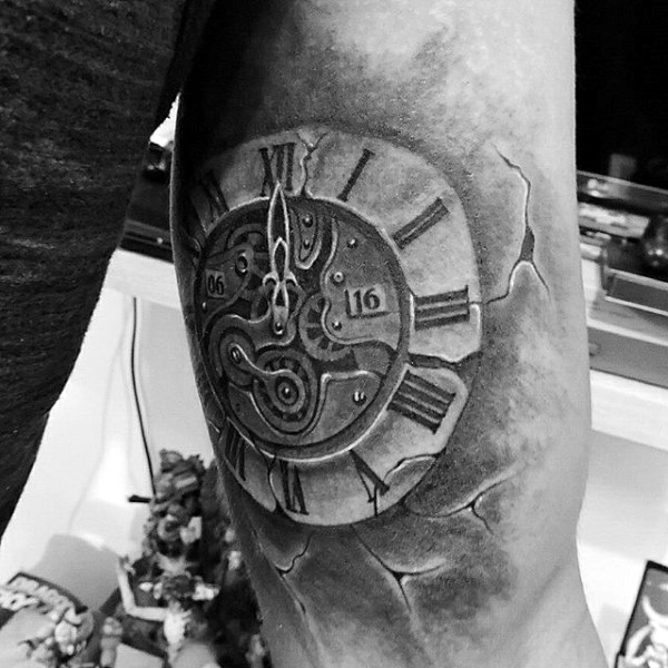 Little black ink antic clock tattoo on arm