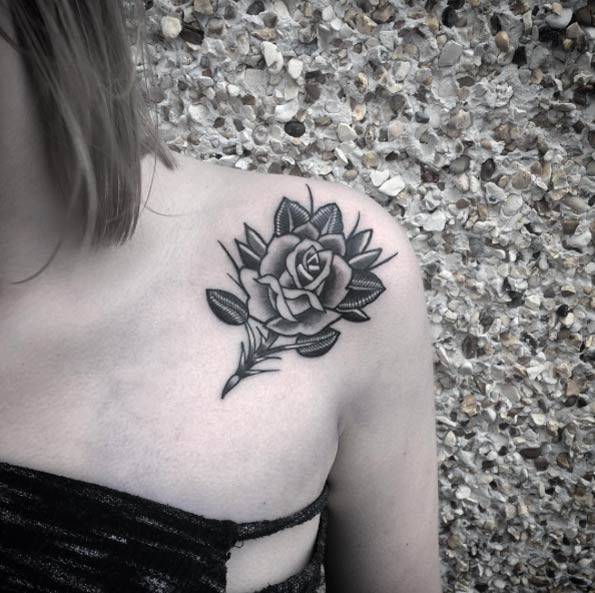 Little black ink cute rose tattoo on shoulder for Small black rose tattoo