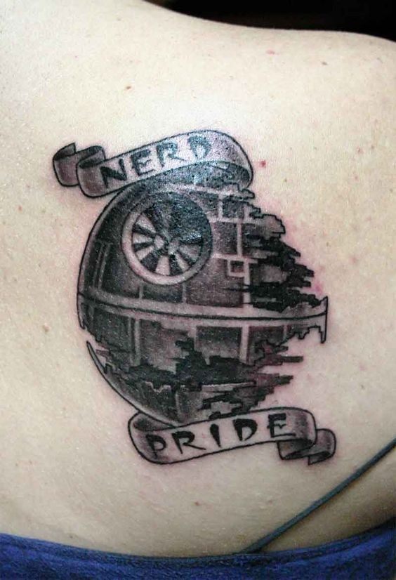 Little black ink death star shaped tattoo on back with lettering