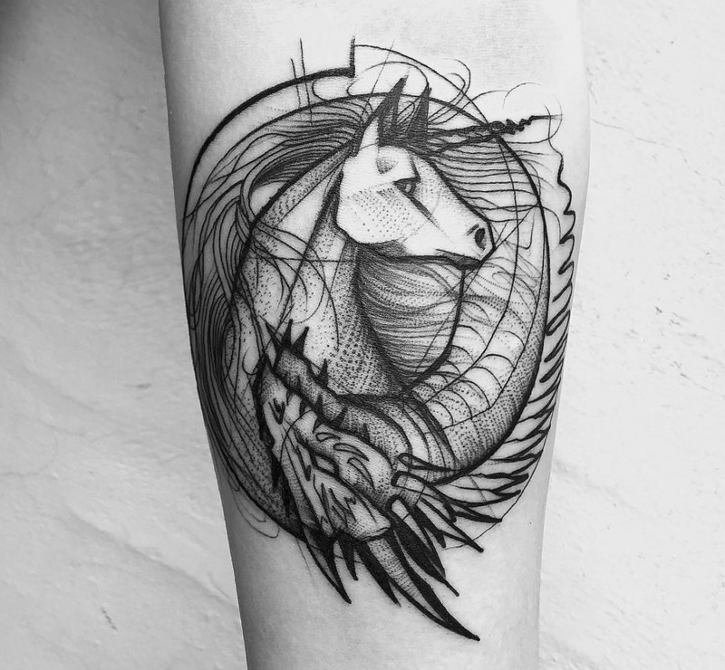 Little black ink forearm tattoo of unicorn with dragon