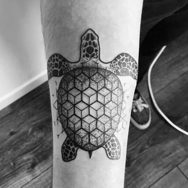 Little black ink geometrical forearm tattoo of turtle