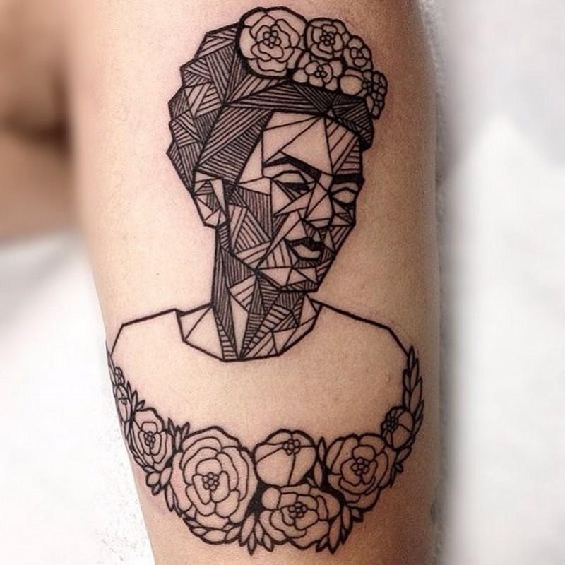 Little black ink geometrical tattoo on forearm