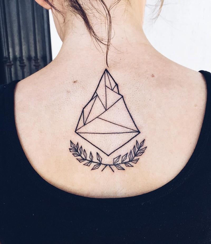 Little black ink geometrical tattoo on upper back with laurel wreath