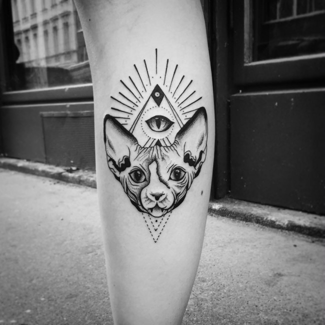 Little black ink leg tattoo of mystical cat face with geometrical figures and eye
