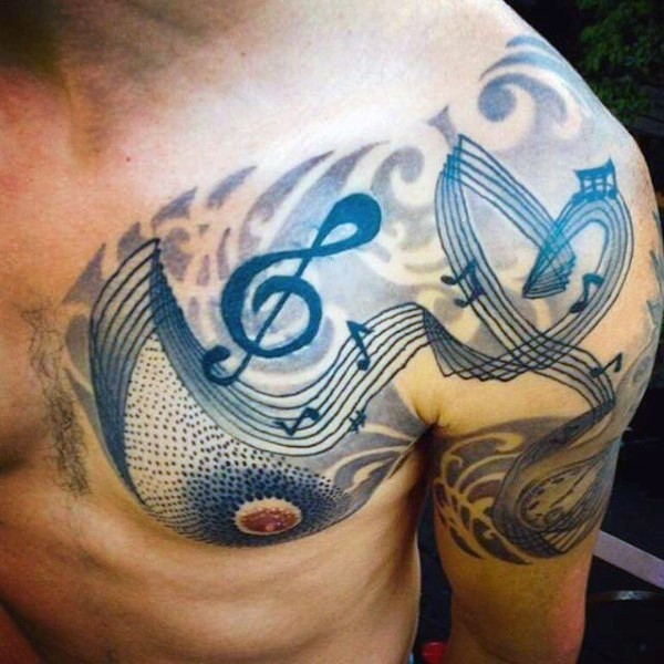 Little black ink music notes tattoo on chest and shoulder