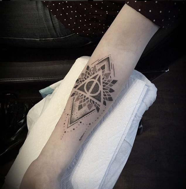 Little black ink mystical forearm tattoo of geometrical flower and pyramid