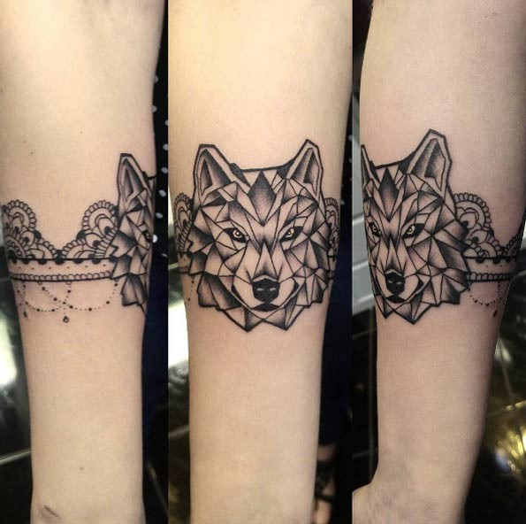 Little black ink painted forearm tattoo of arm band combined with wolf